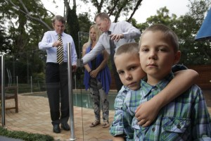 RLSNSW CEO David Macalister, Minister Don Page, twin boys Seth and Braith Hedley (who survived a near drowning in a backyard pool) and their mother Belinda Hedley